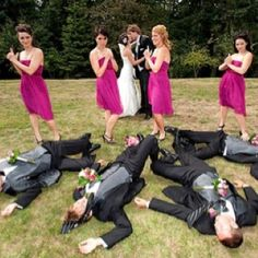 Wedding pose - hysterical, and look at how pretty those bright pink dresses are. ;)