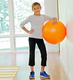 Three fun bouncy ball #exercises for children! A big bouncy ball makes even the work of getting fit seem fun. Kids as young as five can reap the benefits and the balls naturally lend themselves to playful movement while improving balance, strength and stability. #fitness