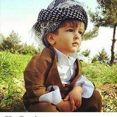Adorable Kurdish Boy in traditional Costume.