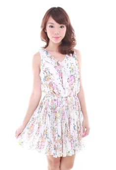 Ada Floral Dress. A pretty number with romantic pastel floral prints and ruffle at the top. Comes with a flowy, pleated skirt. Made of quality chiffon blend. Elastic at the waist.    Available at www.LaceAndButtons.com!