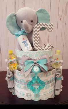 Teal and grey elephant diaper cake.  Perfect baby shower gift! Gender neutral diaper cake. Visit my Facebook page Simply Showers for more pics and orders. Kim