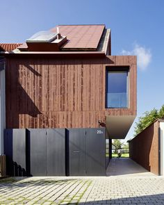This red concrete house outside Stuttgart has an oversized middle floor that cantilevers across the driveway #Architecture