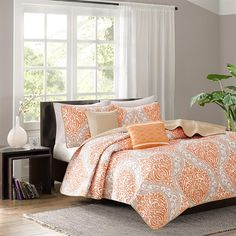 Senna is the perfect way to make a fashion statement in your bedroom. The vibrant orange and taupe damask print adds a pop of color to this coverlet. Two embroidered decorative pillows are included in this set for a finished look.