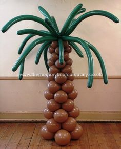 We made these palm tree balloon columns to fit a pirate theme