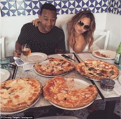Tucking in: The couple have recently been in Europe and enjoyed a pizza feast in Naples...