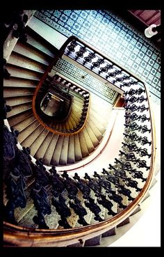 Hypnosis and mesmerisation share the lowest common denominator of repetition. In this case the stairs spiral formation is enough to distort space and bearings. This picture in a certain context can add to a narrative of disorientation, although can stand alone as functionally hypnotizing.