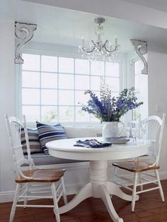 Breakfast nook with window seat . Like how they installed a chandelier up above the window seat. Kitchen Benches, Kitchen Nook, Kitchen Banquette, Kitchen Seating, Kitchen Tables, Kitchen Ideas, Bay Window Kitchen, White Round Kitchen Table, Kitchen Dining