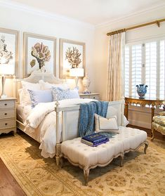 neutrals with pops of blue and white...minus the giant pictures above the bed