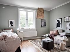 The delicate pale green walls in this apartment make for the perfect setting of the many art prints and accessories that turn this small studio into a cozy and inviting home. Small Apartments, Small Spaces, Color Trends 2018, Inviting Home, Small Apartment Decorating, Small Studio, Scandinavian Home, Home Studio, Minimalist Decor