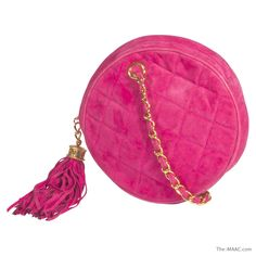 "Chanel shocking pink suede quilted round purse with a pink tassel. Perfect for afternoon or evening wear, circa 1980s. Diameter: 6-3/4""  http://www.the-maac.com/treasures-pleasures?id=67=1135=2685&?_vsrefdom=pinterest"