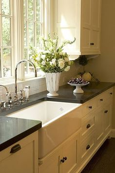 Of course, I love white kitchens with dark countertops! Let me add in this farm sink...dream!