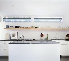single shelf instead of upper cabinets clean horizontal lines suzanne-shaker-kitchen-in-shelter-island. Shaker Kitchen, New Kitchen, Kitchen Ideas, Warm Kitchen, Kitchen Planning, Orange Kitchen, Long Kitchen, Kitchen Magic, Kitchen White