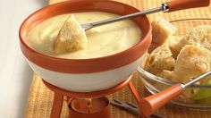 "Fondue is French for ""melted."" Be patient when making cheese fondue, and allow each addition of cheese to completely melt into the wine before adding more."