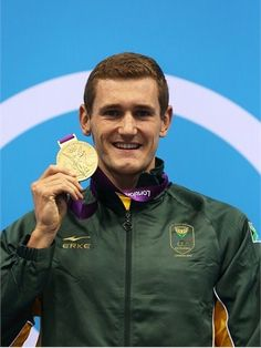 Gold medallist Cameron van der Burgh of South Africa poses on the podium during the Victory Ceremony following the men's 100m Breaststroke final