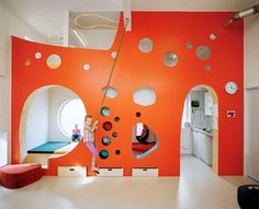"Tromso kindergarten by 70°N arkitektur. Retrofitted ""flexible playing walls"" semi-divide space while still providing connections between and inhabitable spaces between."