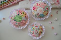 Mini Dresden Plates & Hexie Flower appliqued to top of round pincushions ~> Sweet!