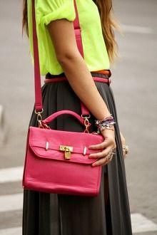 Brown skirt, neon yellow shirt, hot pink bag, colorful bracelets, gold rings, pink nail polish
