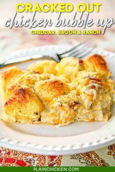 Cracked Out Chicken Bubble Up Recipe - chicken, cheddar bacon, ranch, chicken soup, sour cream and biscuits baked casserole. SO addictive! I literally licked my plate!