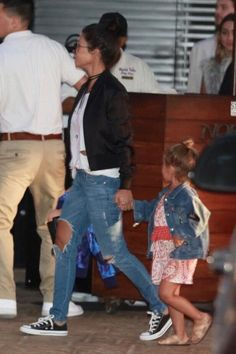 Kourtney Kardashian wearing Converse Chuck Taylor All Star Sneakers in Black and…