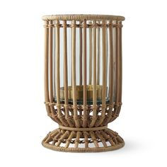 Natural rattan lends a relaxed yet elegant look to this cylindrical hurricane. Skilled artisans weave each one by hand using carefully selected natural reeds, which expertly showcase pillar candles. Designed in collaboration with lifestyle expert … Hurricane Candle Holders, Votive Candles, Hurricane Glass, Black And White Marble, Black Glass, Rattan, Wicker, Ginger Jars, Williams Sonoma