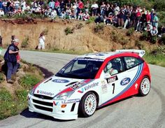 With Ford being a team that has been engulfed in a blanket of racing pedigree from the days of old, the Focus RS is a car that has thrived both on and off the track. Sport Cars, Race Cars, Ford Focus Svt, Rallye Wrc, Ford Motorsport, Colin Mcrae, Car Camper, Campers, Ford Rs