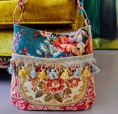Spring floral bags in yellow and blues with tassels