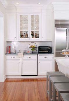 toaster oven in corner next to fridge