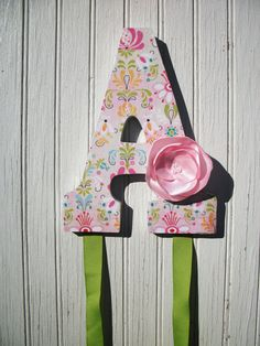 custom bow holder... idea for the girls hairbhows in their bathroom... maybe... I'll pin a few girlies and you guys tell me which one you like best :)