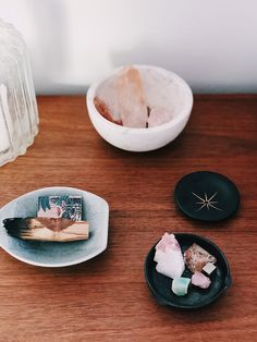 healing crystals in assorted ceramic dishes. / sfgirlbybay