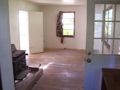 The door was wide open.  The house used by squatters.  It was a cabin in the rough.