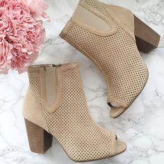 """2 left! Toni Peep Toe Booties An on trend peep toe bootie with perforations. The light beige suede is a staple color that pairs beautifully with all colors and seasons.  Approx 4"""" stacked heel  c o n t e n t Faux suede  c o l o r + beige  h o s t  p i c k 6/5/2016 • Street Style 🎒🕶 8/1/2016• Top Trends 💄🕶  p a i r w i t h  🌙  + Henderson skinny jeans  + Sophie bell sleeve romper 💵 bundle for a discount Alyssa's Posh Closet Shoes Ankle Boots & Booties"""