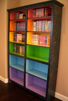 Colored Bookshelves    This could seriously go into so many categories.   Large family life-everyone already has their own color so use the shelves to store their stuff  Homeschool-same as large fam. only each child's curriculum on their color of shelf.  Crafting- Now your collections have their own home. Need a pink button? Check the pink shelf!