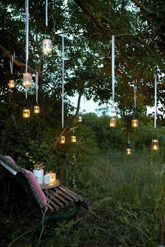 Mason Jars with tea lights hanging from trees