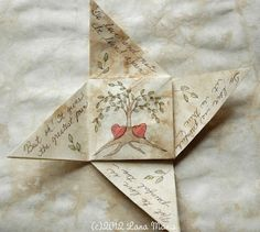 Do you remember playing with Valentine's themed paper fortune tellers, when you were either in elementary or junior high school? This beautiful handmade paper whimsy is reminiscent. It comes from #SimpleJoysPaperie  #Honeysucklelane