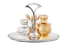 This extraordinary set contains a salt and pepper shaker, a cup for tooth pics as well as a tray with handle, all made from 925 Sterling silver. The rim of the tray is adorned with an Empire style pattern. The salt shaker is gold-plated as well, adding to the refined look of this set. Create your wedding list with Boulesse.com and get access to Vienna's most established and finest shops! https://boulesse.com/en/product/3069/Jarosinski-Vaugoin/Salt-Pepper-Shaker-Set