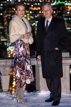Mathilde, 45, opted for aprinted silk midi dress, which she teamed with a fur shawl...