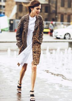 alexa chung. the white dress lightens the heavy feel of the outfit due to the leopard print.