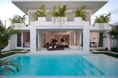 Architecture, Sweet Rectangular Outdoor Swimming Pool Of Contemporary Duplex House Design Near Patio With Unique Rattan Chair And Decorated By Greenery: Contemporary Duplex House Design with Stylish Open Space Concept