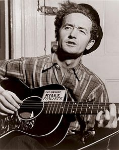 """Woody Guthrie.   """"Yes, as through this world I've wandered  I've seen lots of funny men;  Some will rob you with a six-gun,  And some with a fountain pen""""  (""""Pretty Boy Floyd"""")"""