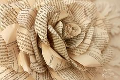Really great tutorial on how to make a lovely paper rose - just hot glue and paper involved!