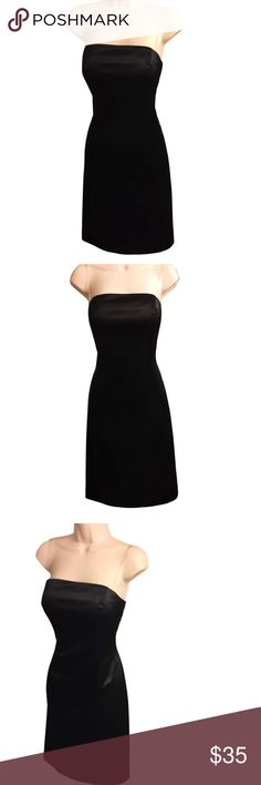 """Black Strapless Cocktail Dress This stunning black strapless dress from White House Black Market is perfect for a special occasion or night out! The dress is fitted, fully lined, w/back zip. There are loops for a belt/sash that I no longer have. 32"""" from the top to bottom of dress. Boning & gripping around the inside of the top of the dress shape & help keep dress in place. Measurements taken w/dress laying flat, not stretched. Bust: 17.5"""", Waist: 14"""", Hips: 19"""". Having seen little wear, the…"""
