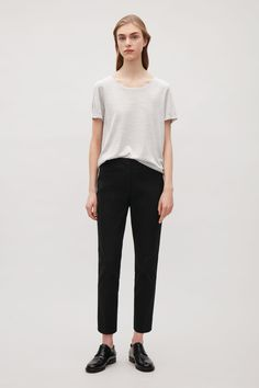 COS image 4 of Slim press fold trousers in Black