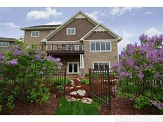 Lovely lilacs greet you this backyard entrance.