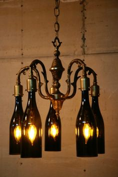 I completely rebuilt and rewired this antique chandelier and altered the design by turning the arms upside down. I then drilled and threaded brass cups to accept the wine bottle neck that is held in place with three thumb screws.…