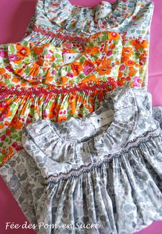 A Trio of Pretty Smocked Dresses with a scoop neckline and a  ruffled collar  -  like the one on Ms Jenkins pattern Pascale from Martha Pullen.
