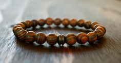www.lotusandlava.etsy.com **Zebrawood is a name that is used for a wood that resembles the striping of a zebra, with dark stripes on a light background. The name originated from the wood of a large tree native to Central America. It is said wearing any type of wood keeps you grounded and closer to the earth. Wood symbolizes balance and represents life, growth, and renewal.**