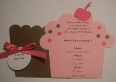 """Cute idea, make the """"wrapper"""" like a pocket and then the cupcake pulls out with the invitation information.  Cute."""