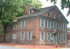 Amstel House, New Castle, Delaware - Is said to be haunted by an entity that also haunts the David Finney Inn, which leads people to believe that the ghost is likely a Finney family member. The entity is most commonly spotted on the third floor of both houses and manifests itself by opening and closing doors and windows, and moving objects through the air.