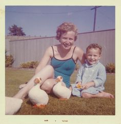 https://flic.kr/p/ETB6Lu | Mother and son playing in the grass | Sep. 1963
