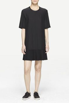 "Silk charmeuse t-shirt shift dress 100% black 19mm silk charmeuse Relaxed, easy pull-over fit Keyhole closure detail at back neck Micro-pleat detail at hem Silk charmeuse binding detail at neck line & center back seam Model is 5'9"" wearing size 2"